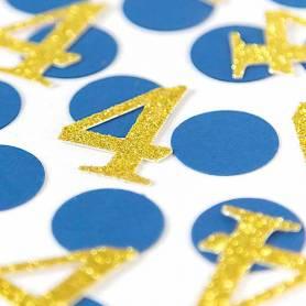 Coriandoli blu e numero oro
